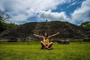 Woman with Arms outstretched in front of Mayan ruins