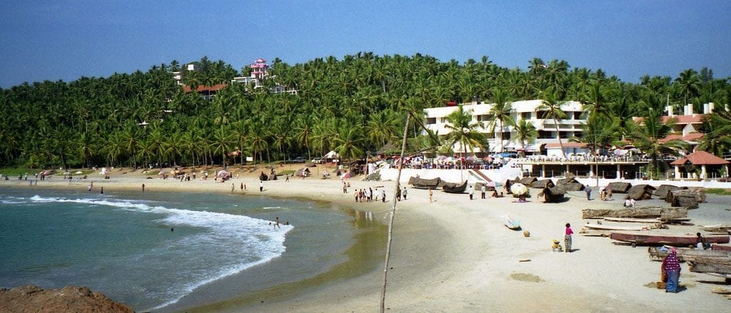 people relaxing on the beach in goa