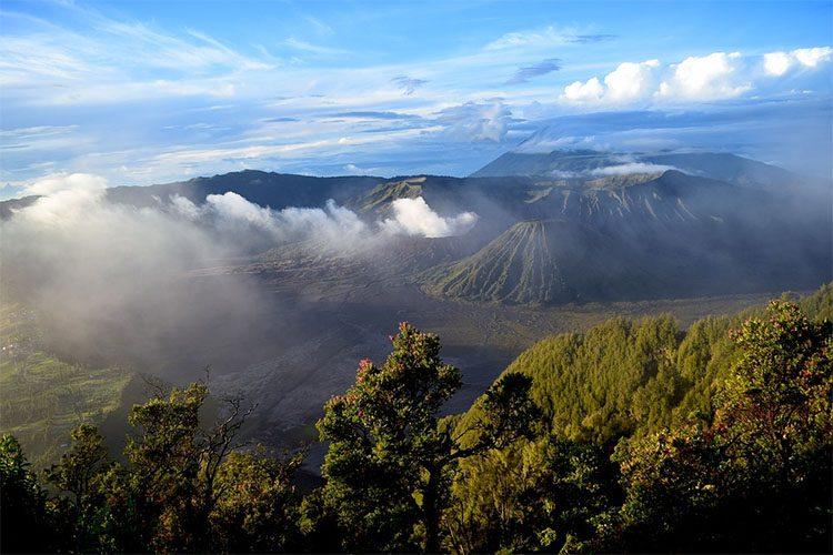 the sun shines on Indonesian hills