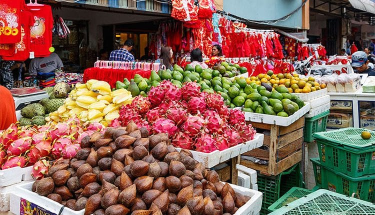fruits and vegetables for sale at an outdoor market in Indonesia
