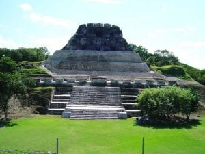 Stone Mayan ruins with lush green surroundings