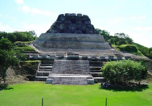 Stone Mayan ruins with lush green surroundings