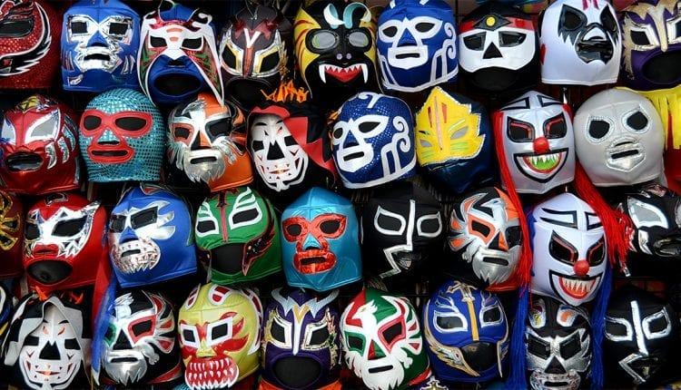 colorful mexican wreslter masks hanging on a wall