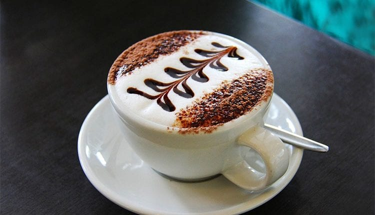 a beautiful coffee with decorations on the steamed milk