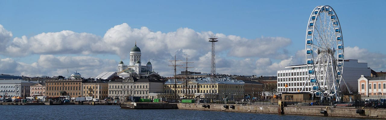 a harbor in helsinki with a ferris wheel