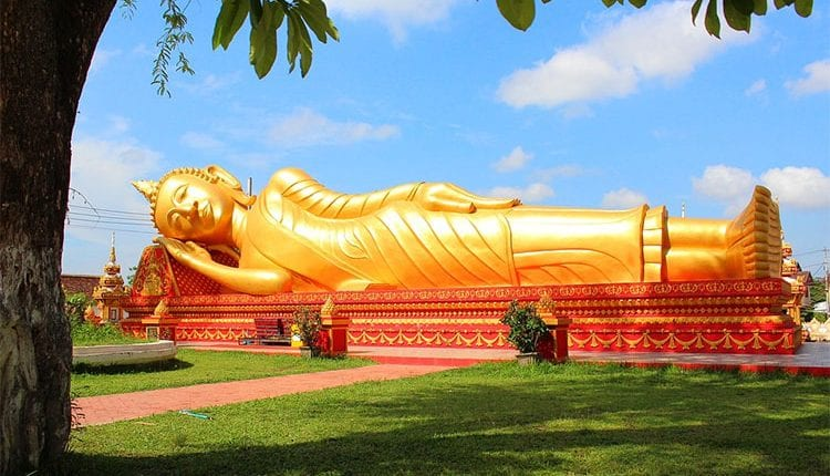 a gold reclining buddha statue in laos