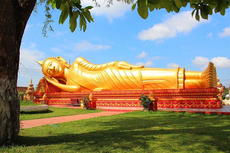 a gold reclining buddha statue in laos