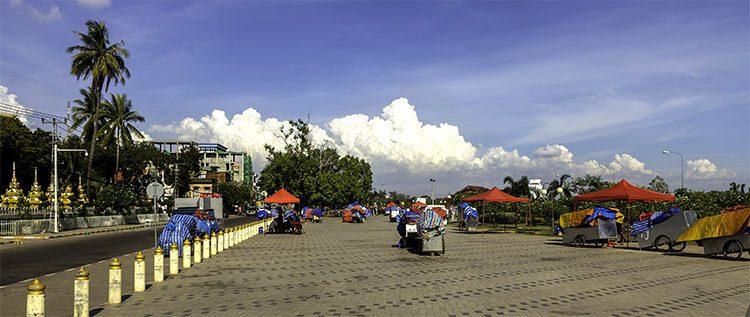 venfor carts on riverfront sidewalk in laos