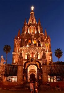 A beautiful baroque cathedral lit up at night
