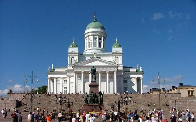 a white cathedral in a plaza in helsinki