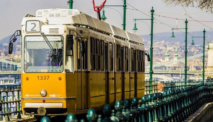 the yellow Budapest tram on an elevated track
