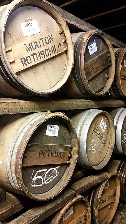 wine barrels lying on their sides on shelves