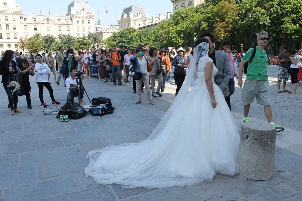 Asian couples taking wedding pictures at the Notre Dame Paris
