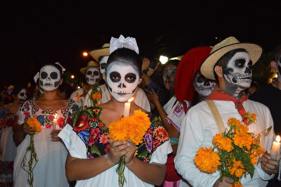 People dressed up and faces painted for Dia de Los Muertos