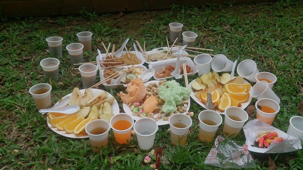 Food and drinks laid out on the group as an offering for hungry ghosts