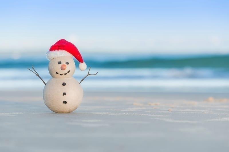 Sandy Snowman on a beautiful sand beach.