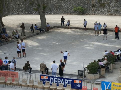 Watch a game of pétanque on the beach just before sunset at Place des Lices