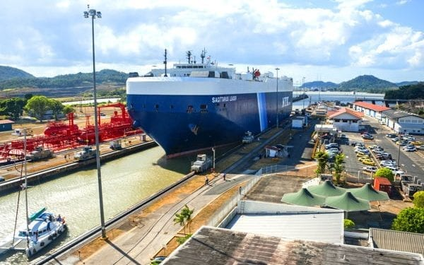 Ship passing through miraflores lock on the Panama Canal