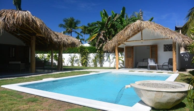 Backyard pool with water feature on a bright day in our backyard of Las Terrenas, Dominican Republic.