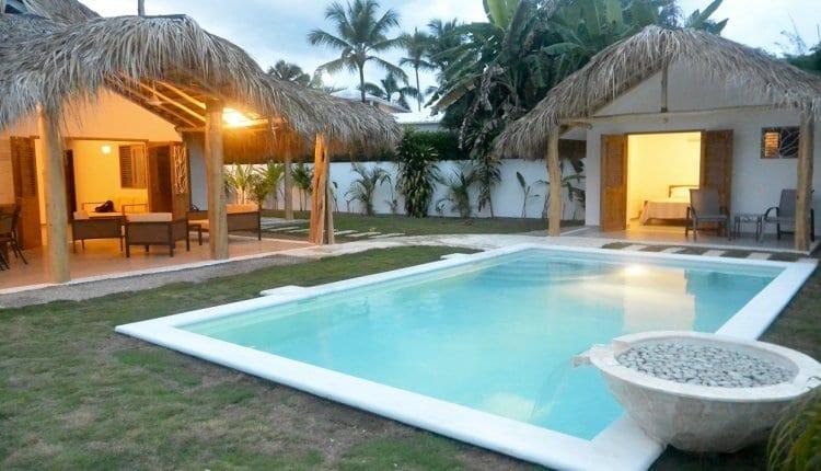 Backyard pool and home in Las Terrenas at dusk.