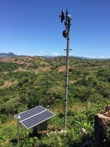 Solar Powered Internet Tower at Los Islotes, Panama. Countryside Hills And Mountains In Background