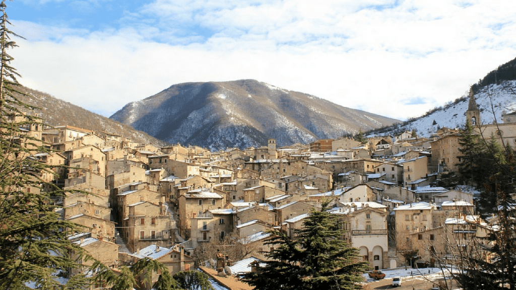 Abruzzo Italy, snow capped mountain in the background with old town in the foreground