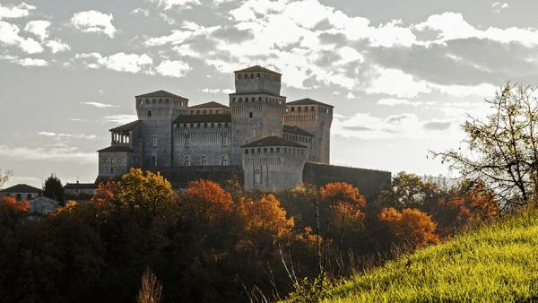 Castle Toastling on the outskirts of Parma in the autumn with the leaves on trees turning orange. One of the best Places to Live in Italy today