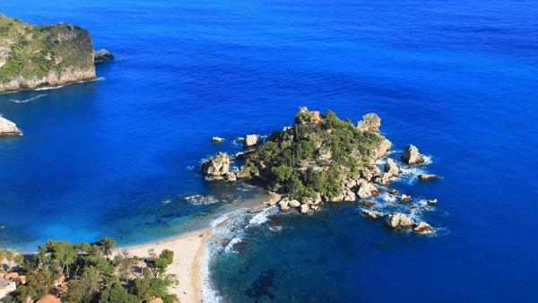 Aerial view Sicily coastline, rocky outlet and blue seas.