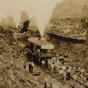 historic train and men working on the original digging of the panama canal