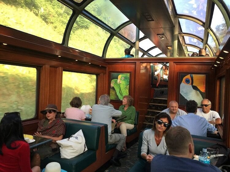 view of the one of the carriages in the panama canal train. old style carriage with wood panels and glass ceiling