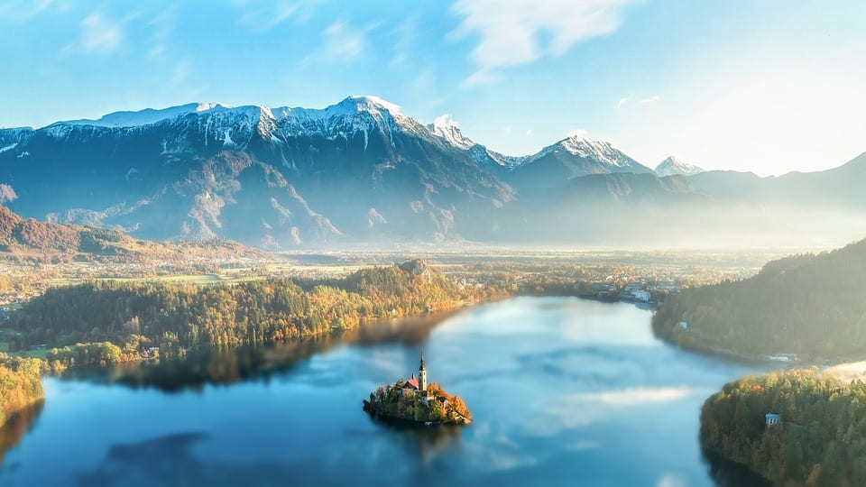 Aerial view of Lake Bled and the surrounding wilderness