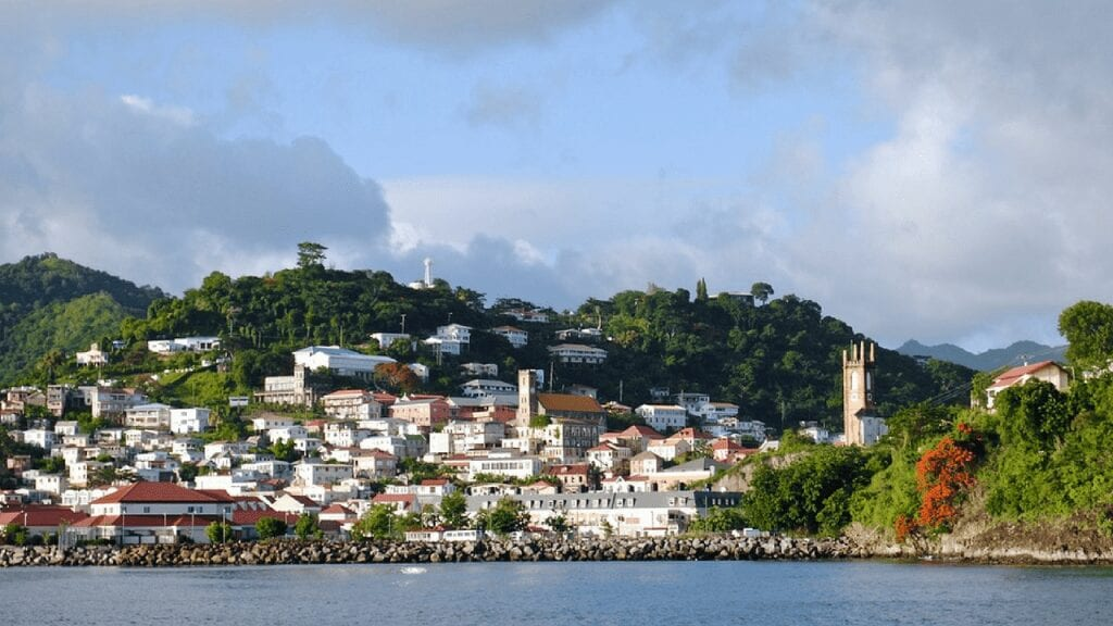 view from the sea of a bay in Grenada. Grenada is one of the cheapest places to live in the Caribbean.