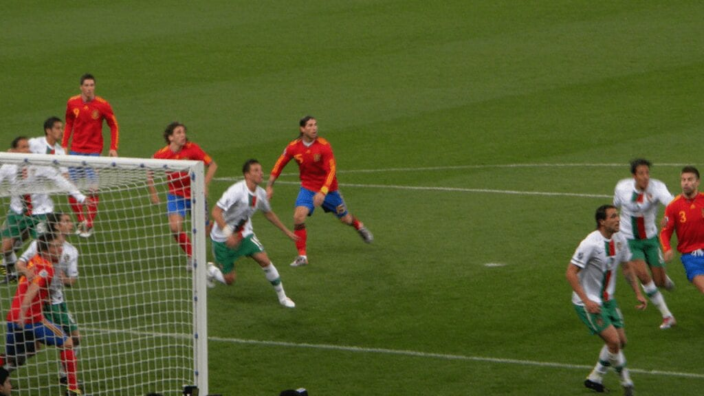 spain vs portugal international. ramos and puyol run for a header