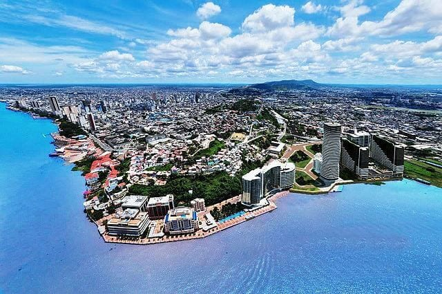 An aerial view of Guayaquil, Ecuador with property all along the coast.