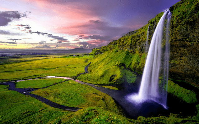A waterfall in Iceland flows into a river