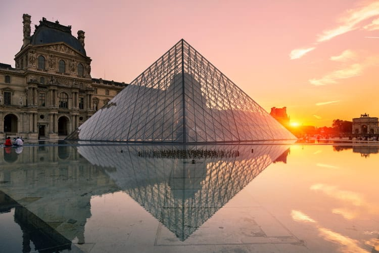 Louvre pyramid at sunset