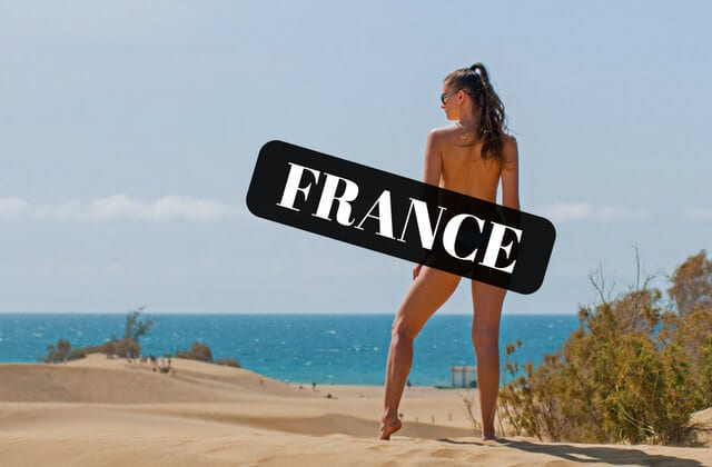World's best nude beaches. A female nudist at the beach in France covered by black box saying France.