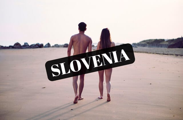 A naked couple walking along one of the world's best nude beaches in Slovenia covered by black box saying Slovenia.
