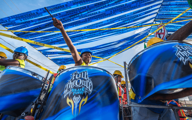 A drummer playing at a street parade in Belize