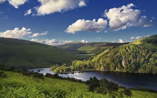 A lake in Ireland set amongst tree covered hills
