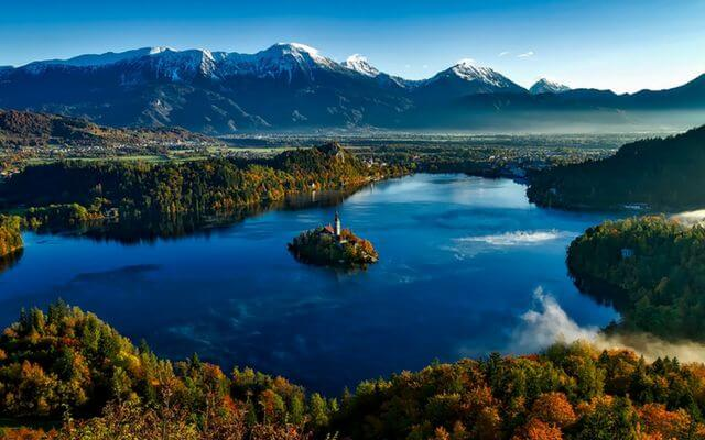 A lake in Slovenia near to Bled. Wild countryside with mountains in the distance