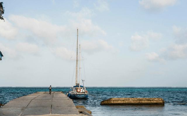 Yacht by jetty in Belize