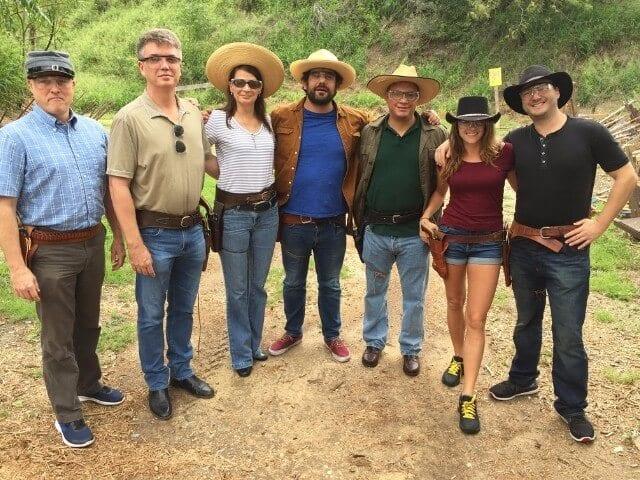 Seven people wearing cowboy hats