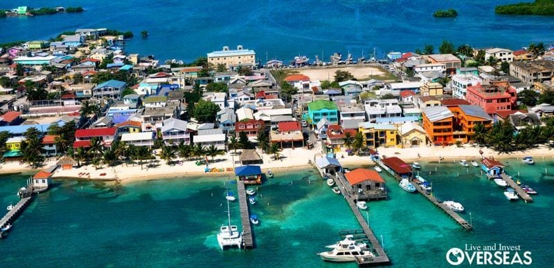 colorful buildings on ambergis caye with docks and boats
