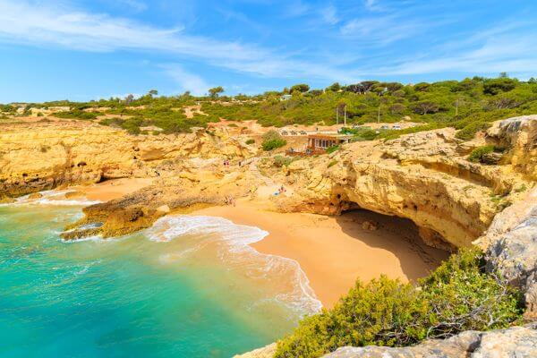 albandeira portugal beach yellow sand clear blue waters