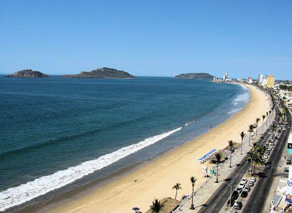 view looking across the beach in mazatlan mexico on a sunny day