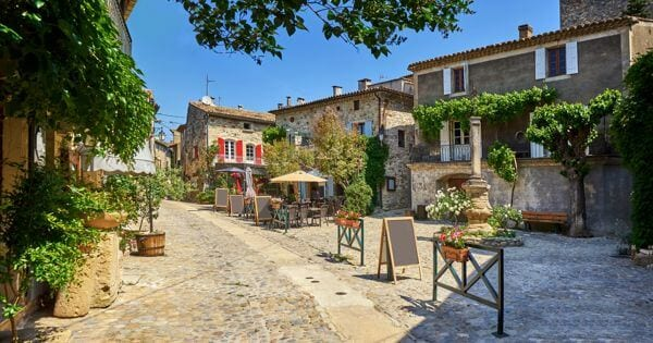 quiet town in occitanie. a small cafe with tables outside