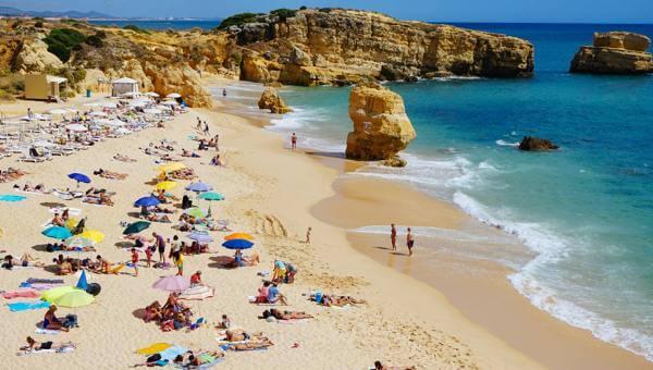 praia de sao rafael beach sunbathing and sun umbrellas