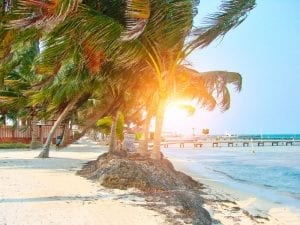 A yellow sand beach in Belize. Should you move to belize?