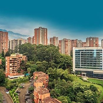 a park with buildings all arround mad eof bricks, in medellin colombia